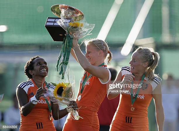 Maartje Scheepstra Janneke Schopman and Minke Booij of the Netherlands celebrate with the trophy after winning the 7th Women's European Nations...