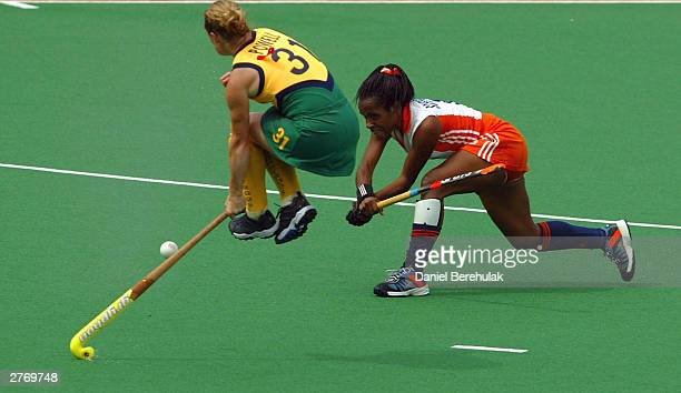 Maartje Scheepstra of the Netherlands hits a ball past Katrina Powell of Australia of Australia in action during the BDO Hockey Champions Trophy...