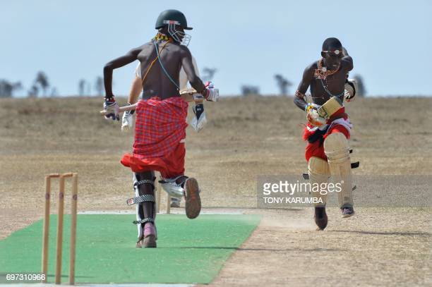Maasai cricket warriors score a run against opponents from the British Army Training Unit Kenya team on June 18 2017 during a cricket tournament...