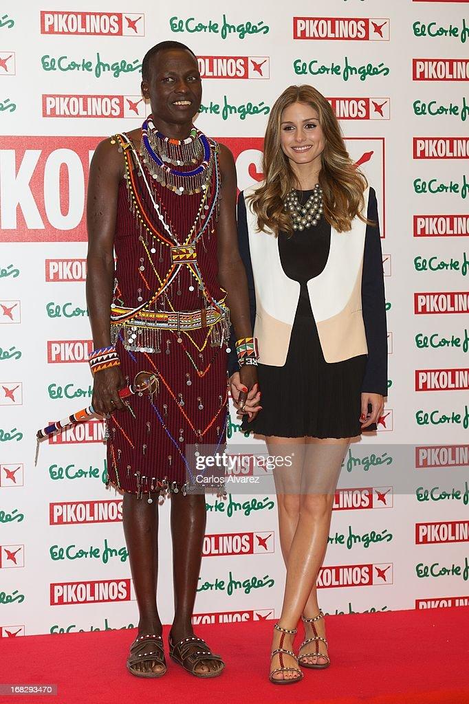 Maasai leader William Kikanae and Olivia Palermo present the new 'Pikolinos' Maasai collection at the Corte Ingles Castellana store on May 8, 2013 in Madrid, Spain.