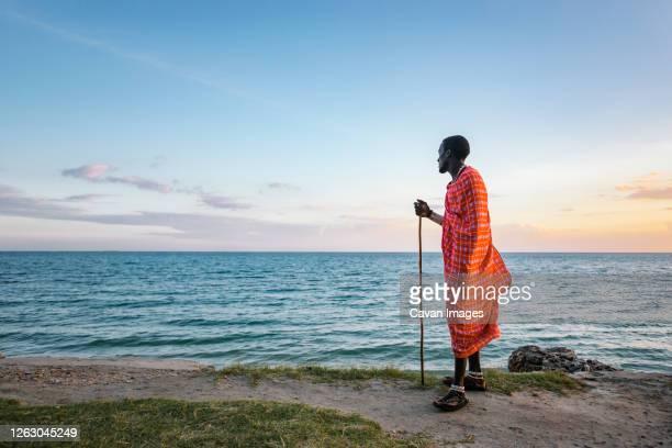 maasai man on the beach - kenya stock pictures, royalty-free photos & images