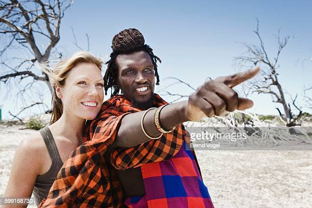 Maasai Man Pointing Something Out to Woman