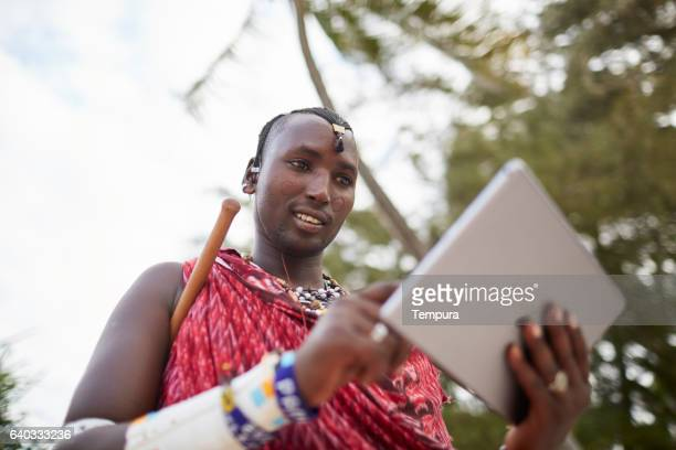 Maasai nomadic man using technology