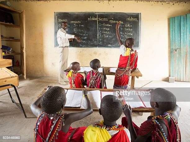 maasai school children in traditional costume. kenya. - hugh sitton photos et images de collection