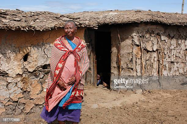 Maasai Tribe Women Standing in Front of Mud Hut