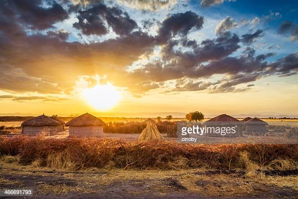 maasai village by sunset - tarangire national park - village stock pictures, royalty-free photos & images