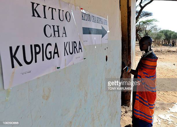 A Maasai waits to cast her vote on October 31 2010 near Arusha during Tanzania's presidential and parliamentary electionsTanzanian polls expected to...
