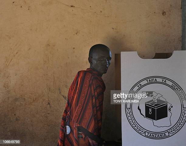 A Maasai walks towards a polling booth on October 31 2010 near Arusha during Tanzania's presidential and parliamentary electionsTanzanian polls...