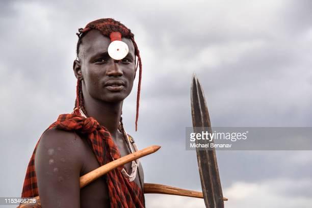 a maasai warrior, at maji moto, kenya - eastern african tribal culture stock photos and pictures