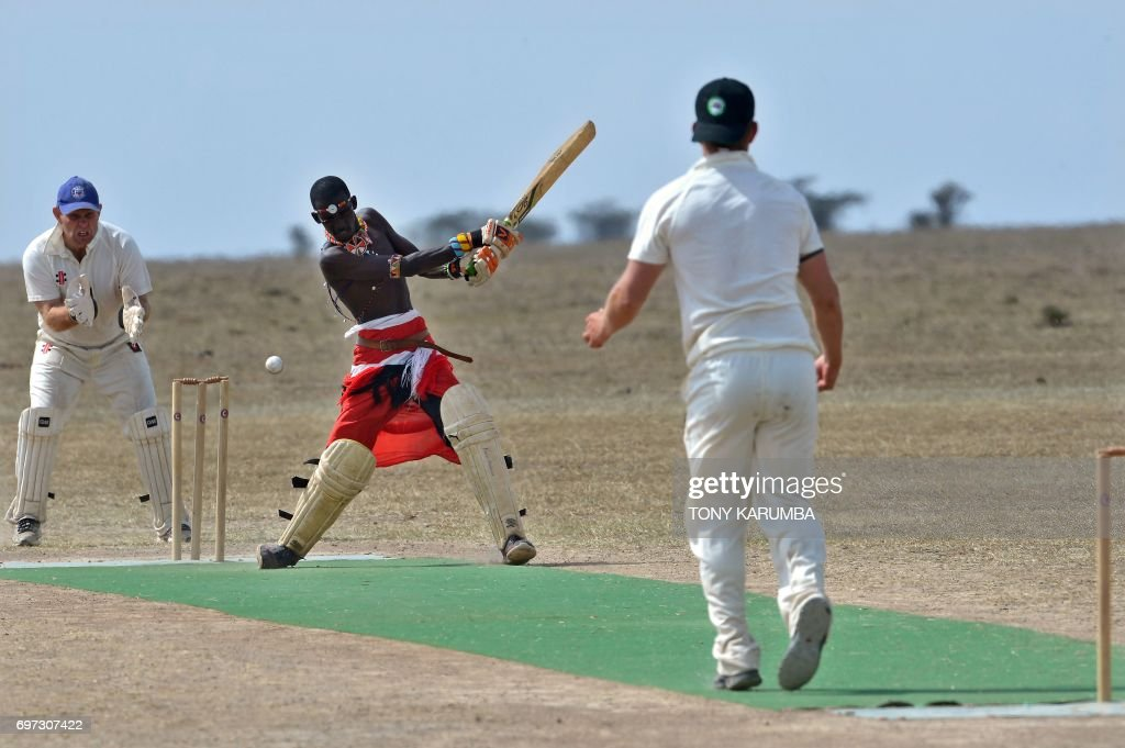 A Maasai warrior bats against a bowler from the British Army Training Unit Kenya (BATUK) team on June 18, 2017 during a cricket tournament played in the wilds of Laikipia county's Ol-Pejeta Conservancy, at the foot of Mount Kenya, and home to the last three northern white rhino sub-species on the planet. The two-day tournament dubbed 'Last Male Standing' is an annual charity event that aims to raise awareness of the plight of the nothern-white rhino and creates funding to continue ongoing research into ways to save the sub-species from extinction. /