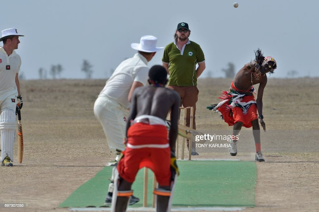 A maasai warrior bowls a cricket ball against an opponent from the British Army Training Unit Kenya (BATUK) team on June 18, 2017 during a cricket tournament played in the wilds of Laikipia county's Ol-Pejeta Conservancy, at the foot of Mount Kenya, and home to the last three northern white rhino sub-species on the planet. The two-day tournament dubbed 'Last Male Standing' is an annual charity event that aims to raise awareness of the plight of the nothern-white rhino and creates funding to continue ongoing research into ways to save the sub-species from extinction. /