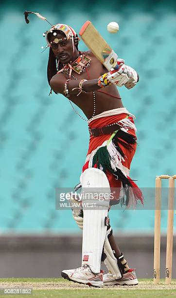 A Maasai Warrior from Kenya plays a shot in their cricket match at the Sydney Cricket Ground against a team comprising of Australian rugby union and...