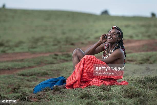 Maasai Warrior on Mobile Phone Smiling