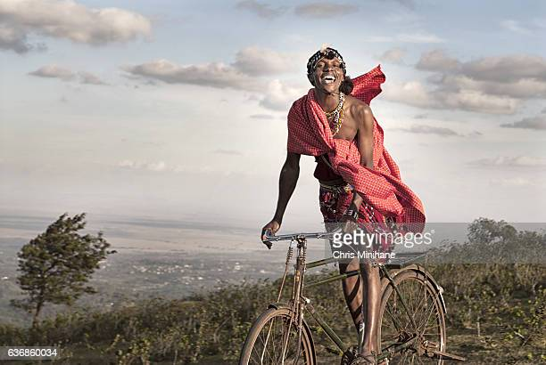 Maasai Warrior Smiling on Bike. Kenya, Africa.