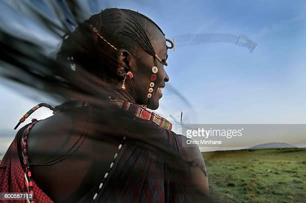Maasai Warrior smiling with long Braids