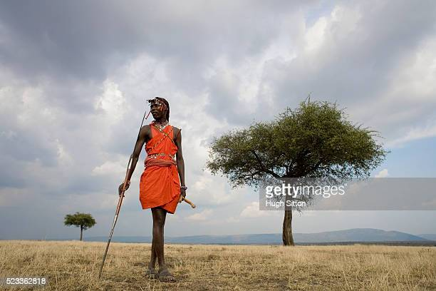 maasai warrior standing with spear - hugh sitton stock pictures, royalty-free photos & images