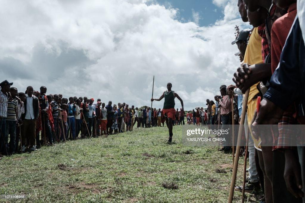 A Maasai warrior throws a javelin instead of a Maaasai spear
