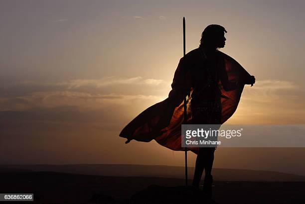 maasai warrior with spear and back lit cape - guerrier massai photos et images de collection