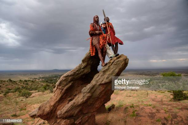 maasai warriors and an american boy at maji moto, kenya - eastern african tribal culture stock photos and pictures