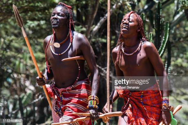 maasai warriors sing and dance at maji moto, kenya - eastern african tribal culture stock photos and pictures
