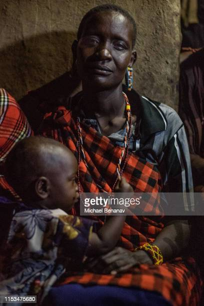 a maasai woman and child in their hut - eastern african tribal culture stock photos and pictures