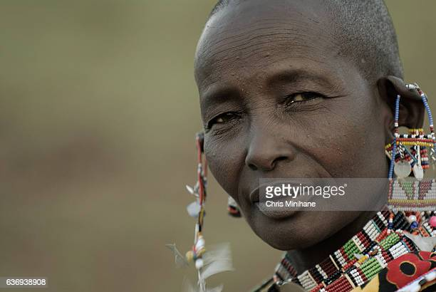 maasai woman with beaded jewelry - masai fotografías e imágenes de stock