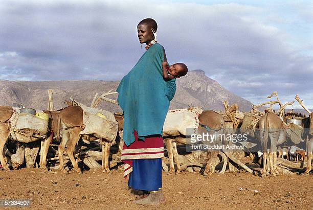 Maasai woman with her young children in the Malambo district of Ngorongoro The region of Ngorongoro in Tanzania is one of Africa's most popular...