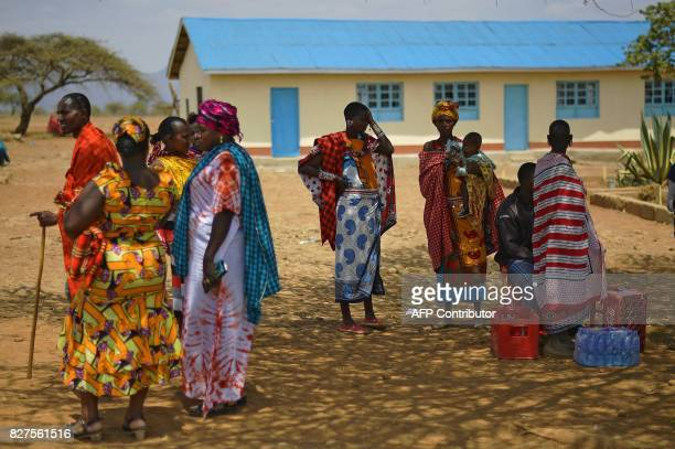 Maasai women gather at a polling station in Ewaso Kendo Kajiado West County on August 8 as the nation goes to the polls in national elections Kenyans...