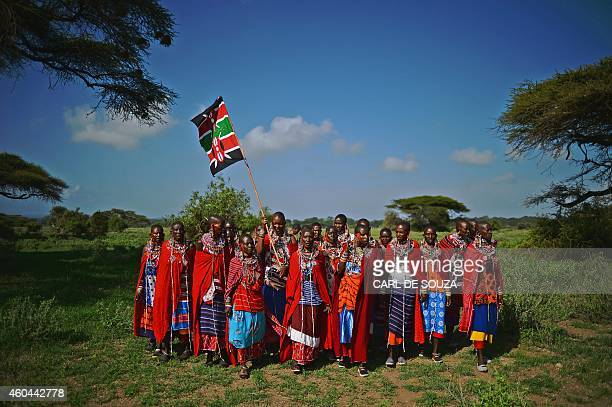 Maasai women sing while holding a Kenyan flag in Kimani on December 13 2014 Leaping high into the air and hurling spears instead of javelins...