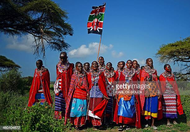 Maasai women sing while holding the Kenyan flag in Kimani on December 13 2014 Leaping high into the air and hurling spears instead of javelins...