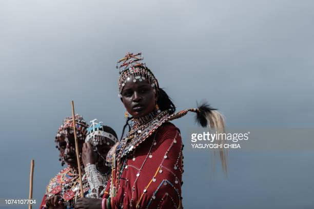 TOPSHOT Maasai young women are on a stage for the ceremony during a sporting event dubbed the Maasai Olympics at Kimana near Kenya's bordertown with...