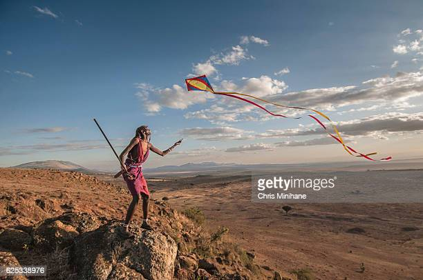 Maasia Warrior Flying Kite and Having Fun with Scenic View