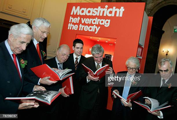 Unidentified officials hold 07 February 2007 paper copies of the Maastricht Treaty that was signed 15 years ago The anniversary will be celebrated...