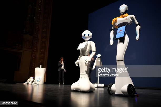 Maava pepper and Nao robots are displayed during the digital tech show in Rennes on December 8 2017 This event dedicated to the development of...
