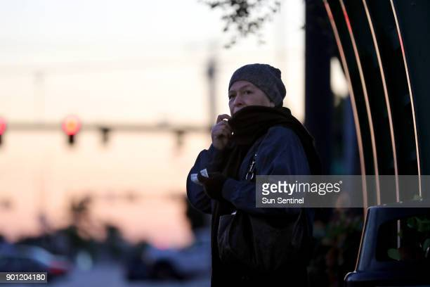 Mabel Alvarez pulls up her scarf as she waits for the bus on Commercial Blvd in Oakland Park on Thursday Jan 4 2018 Alvarez was on her way to babysit...