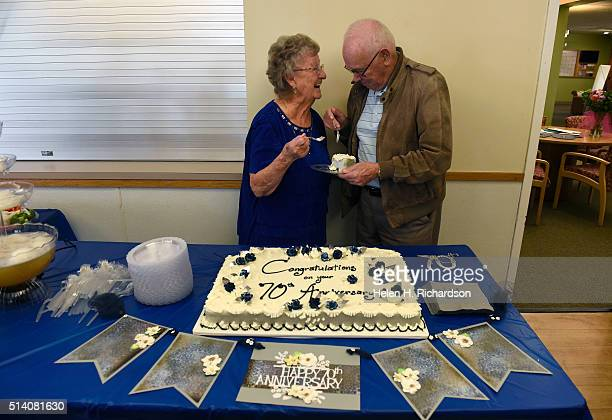 Mabel and Robert Burrows share a piece of cake just like on their wedding day from their 70th wedding anniversary cake at the Broomfield Community...