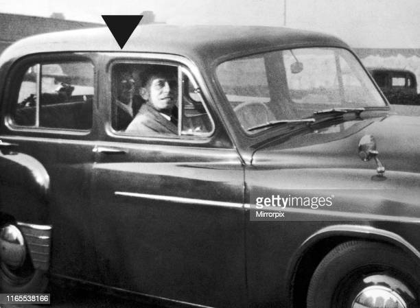 Mabel Chinnery behind the camera taking the picture of his husband Mr Chinnery sitting in the driving seat of a car on his way to visit the grave of...