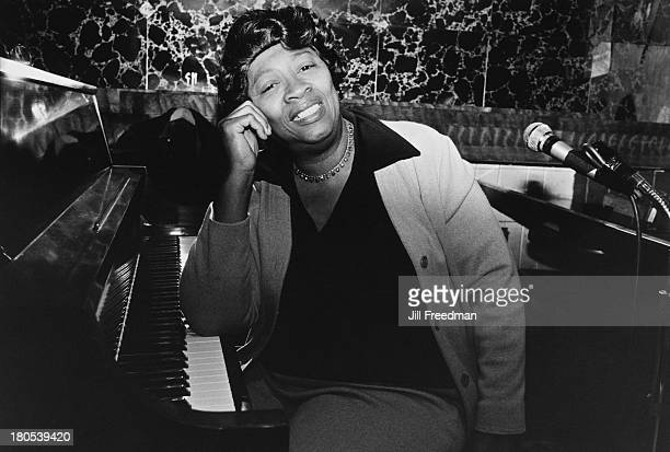 Mabel Godwin poses at the piano in Arthur's Tavern Greenwich Village New York City 1977