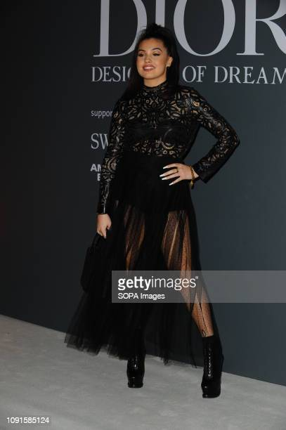 Mabel McVey attends the Christian Dior Designer of Dreams fashion exhibition supported by Swarovski at the VA Museum London