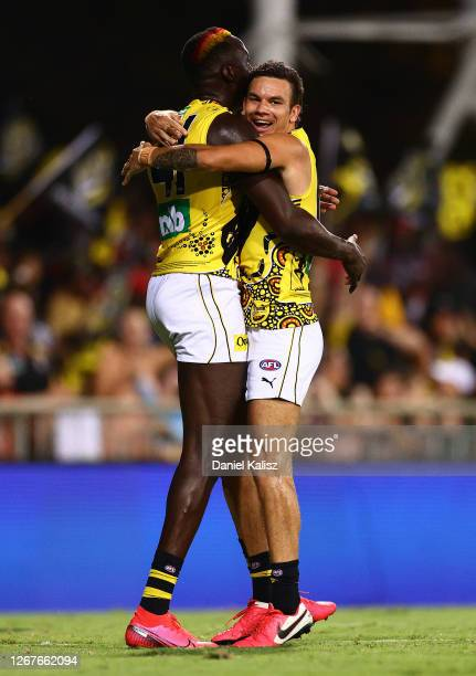 Mabior Chol of the Tigers celebrates with Daniel Rioli after scoring a goal during the round 13 AFL match between the Essendon Bombers and the...