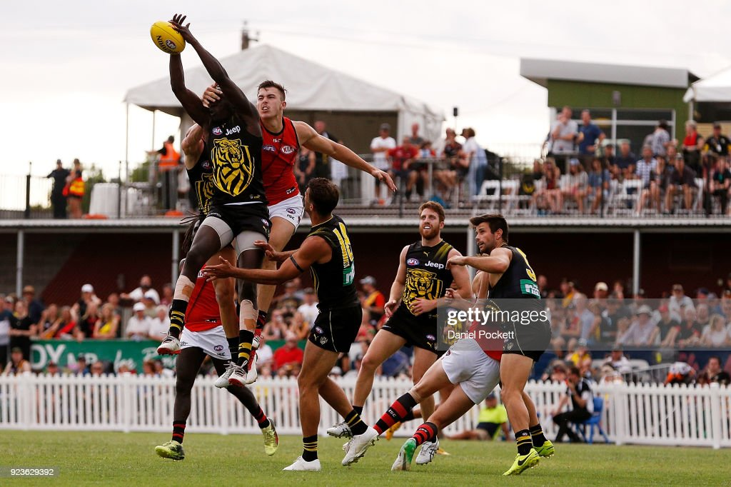 Mabior Chol of the Tigers flies for a pack mark during the JLT Community Series AFL match between the Essendon Bombers and the Richmond Tigers at Norm Minns Oval on February 24, 2018 in Wangaratta, Australia.