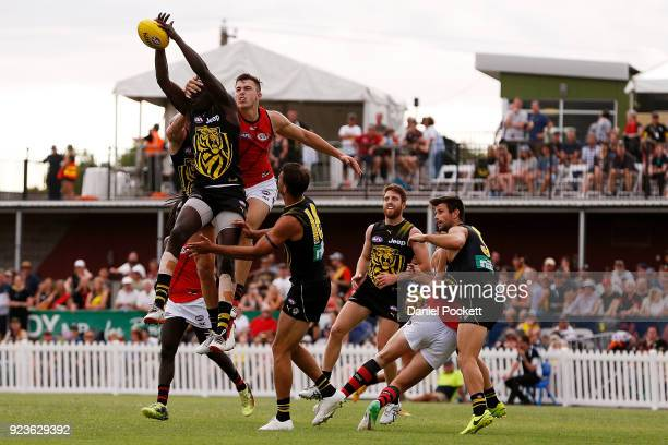 Mabior Chol of the Tigers flies for a pack mark during the JLT Community Series AFL match between the Essendon Bombers and the Richmond Tigers at...