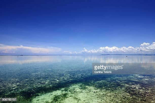 mabul island lagoon - mabul island stock photos and pictures