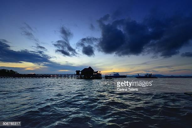 mabul island sunset - mabul island stock photos and pictures