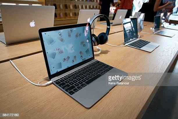 Mac book computers are displayed the new Brooklyn Apple Store during a media preview in the Williamsburg neighborhood of Brooklyn on July 28 2016 in...