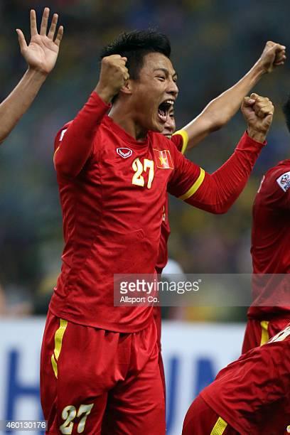 Mac Hong Quan of Vietnam celebrates after beating Malaysia 2-1 during the 2014 AFF Suzuki Cup 1st leg semi final between Malaysia and Vietnam at Shah...