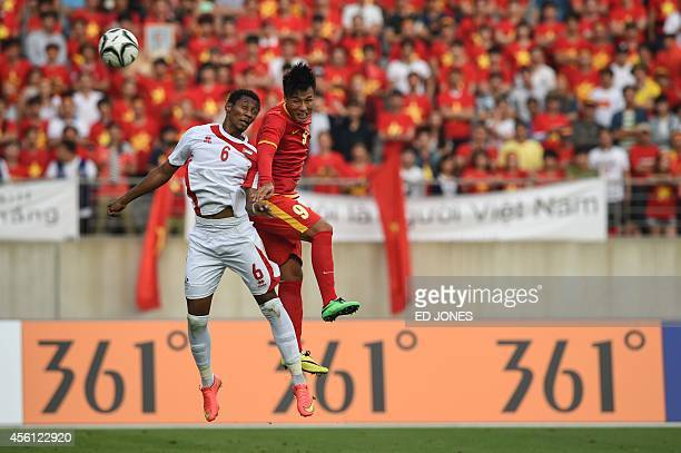 Mac Hong Quan of Vietnam jumps for the ball with Saif Khalfan Saeed Almeqbaali of the United Arab Emirates during their men's round of 16 football...