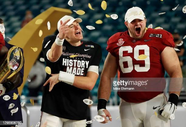 Mac Jones of the Alabama Crimson Tide celebrates alongside Landon Dickerson following their win over the Ohio State Buckeyes in the College Football...