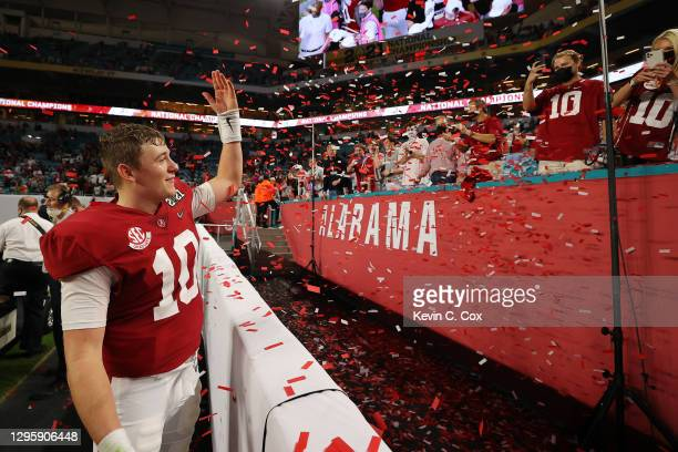 Mac Jones of the Alabama Crimson Tide celebrates defeating the Ohio State Buckeyes 52-24 in the College Football Playoff National Championship game...