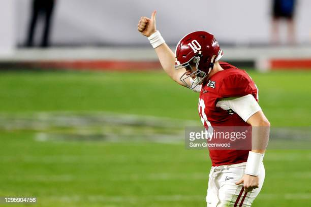 Mac Jones of the Alabama Crimson Tide gestures to the fans as he heads off the field during the fourth quarter of the College Football Playoff...